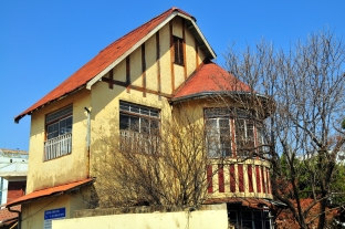 Figure 33. An older photo depicting what was locally referred to as the Daeheung-dong Pointy Roof House, a 1929 culture house influenced residence for the head of the Daejeon Railroad Bureau. It's a fine example of an English Craftsman-leaning culture house. The house was dismantled around 2009 when the area was being redevelopment for apartment blocks, and was reconstructed in 2014 at a new address. This image shows the house as it was before it was dismantled and relocated. Daejeon, Korea. Source: Courtesy of Robert Koehler, 2009.